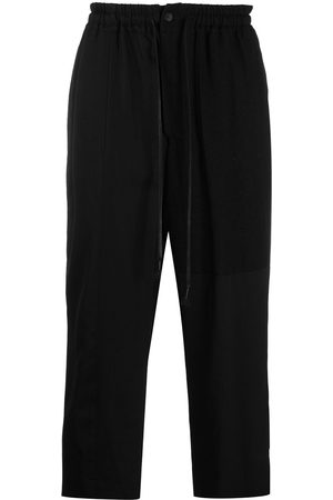 THE VIRIDI-ANNE Wool-blend wide cropped trousers