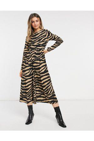 ASOS Long sleeve button back tea jumpsuit in animal print