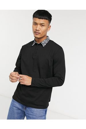 ASOS Relaxed long sleeve polo with contrast collar in