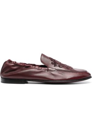 Dolce & Gabbana Debossed-motif polished-finish loafers