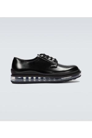 Prada Derby-Schuhe aus gebürstetem Leder