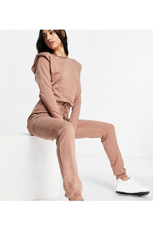 ASOS ASOS DESIGN tall long sleeve shoulder pad jogger jumpsuit in