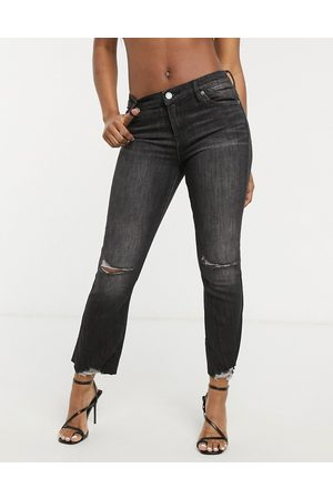 BLANK NYC Distressed knee kick flare jeans in washed