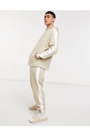 ASOS Oversized tracksuit in with white side stripe
