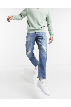 Jack & Jones Intelligence Chris loose fit jeans with rips in