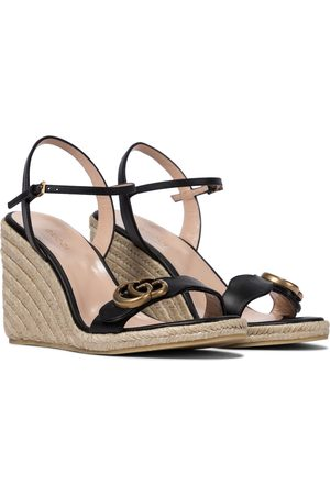 Gucci Wedge-Sandalen GG aus Leder