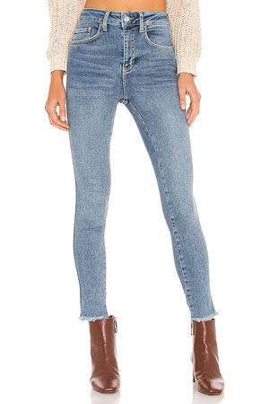 Free People High Rise Jegging in - Blue. Size 24 (also in 25, 26, 28, 29, 31).