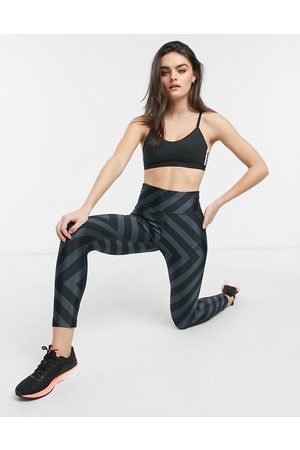 adidas All over graphic tights in