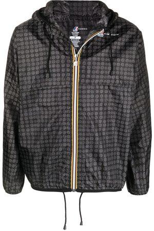 10 CORSO COMO Trenchcoats - Graphic-print hooded raincoat