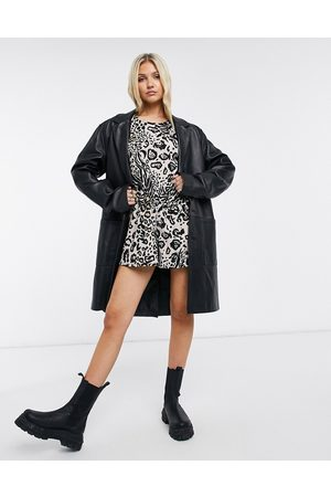 ASOS Button back puff sleeve playsuit in animal print-Multi