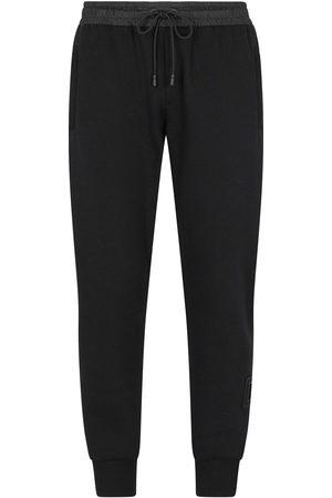 Dolce & Gabbana Herren Jogginghosen - Logo-print tapered-leg track pants