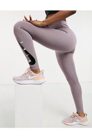 Nike Swoosh 7/8 leggings in purple