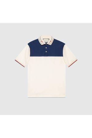 Gucci Herren Poloshirts - Poloshirt aus Baumwolle mit besticktem Kragen