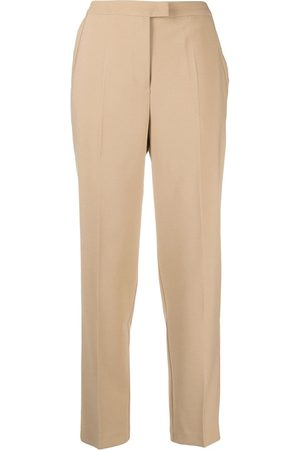 12 STOREEZ Pressed-crease tailored trousers