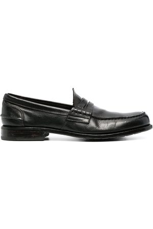 Premiata Crossover-strap leather loafers