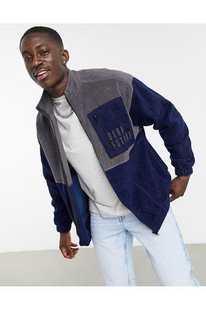 ASOS Dark Future Oversized zip through jacket in grey and navy polar fleece with logo