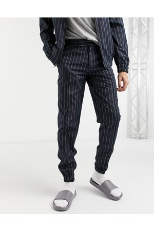 ASOS DESIGN Smart slim fit joggers co-ord in navy pinstripe