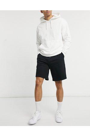 ASOS Oversized jersey shorts in black