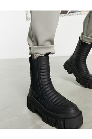 ASOS Chelsea calf boots on chunky sole in black faux leather with padded detail