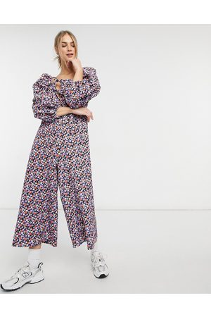ASOS DESIGN Double puff sleeve tie front jumpsuit in purple floral-Multi