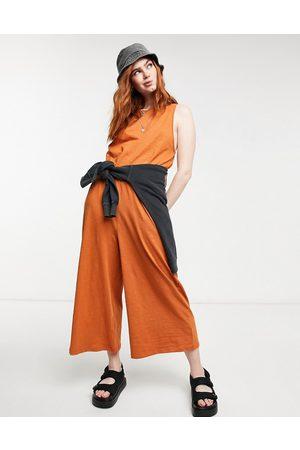 ASOS Minimal sleeveless jumpsuit in rust-Red