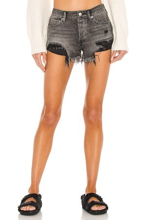 Free People Loving Good Vibrations Shorts in - Black. Size 24 (also in 25, 26, 27, 28, 29, 30, 31).