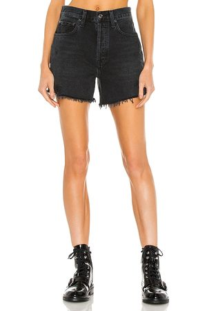 AGOLDE Riley Short in - Black. Size 23 (also in 24, 25, 26, 27, 28, 29, 30, 31, 32, 33).