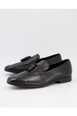 Office Manage tassel loafers in black leather