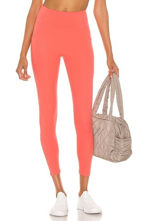 Le Ore Lucca High Rise Legging in - Pink. Size L (also in XS, S, M).