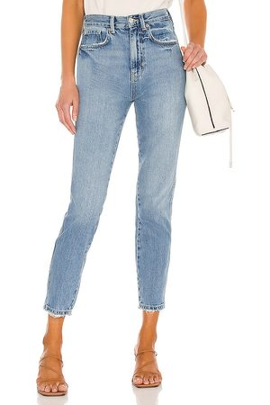 Free People Stove Pipe Jean in - Blue. Size 24 (also in 29, 30, 31, 25, 28, 32).