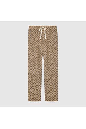 Gucci Herren Leder & Lederimitathosen - Hose aus GG Canvas mit GG aus Leder