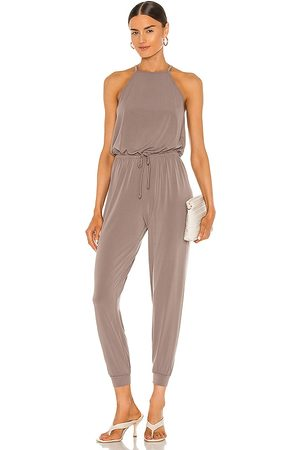 Lanston Halter Jumpsuit in - Taupe. Size L (also in XS, S, M).
