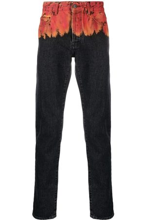 MARCELO BURLON Flame-print jeans