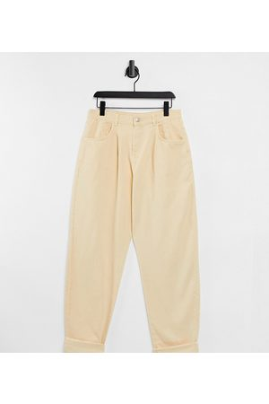Reclaimed Inspired The '83 unisex relaxed jean in pale yellow