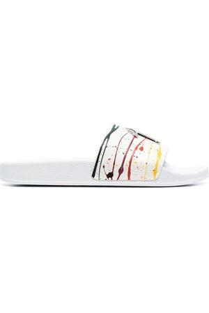 Giuseppe Zanotti Herren Clogs & Pantoletten - Paint-splatter slides