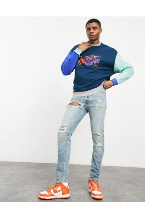 ASOS Skinny jeans in light wash with heavy rips-Blue