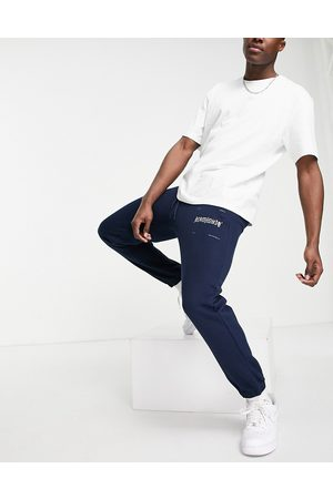 The Arcminute Arcminute slim fit jersey joggers in navy