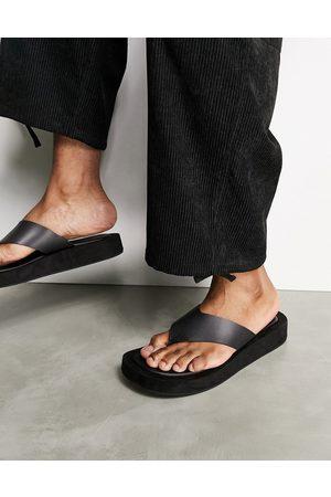 ASOS Flip flop on angular wedge sole in black