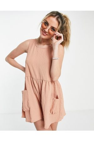 ASOS Smock sleeveless textured playsuit with pockets in blush-Pink
