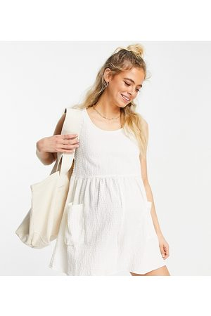 ASOS Maternity ASOS DESIGN maternity smock sleeveless textured playsuit with pockets in cream-White