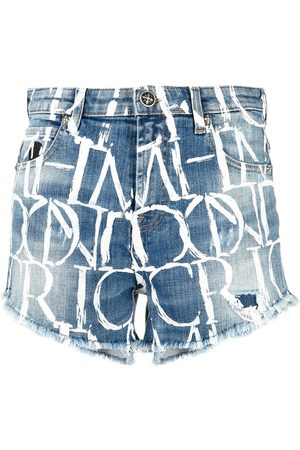 John Richmond Damen Jumpsuits - All-over logo print denim shorts