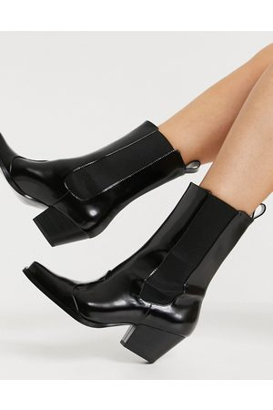 Monki Lexi faux leather square toe western boot in black