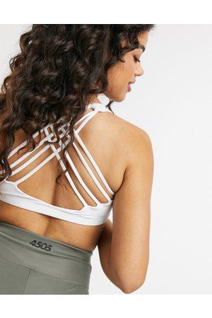Onzie Chic medium support yoga sports bra in white