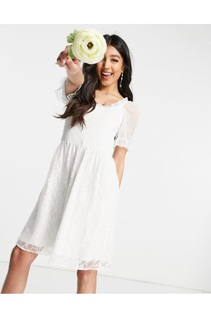 Y.A.S Bridal mini dress with shirred top mesh puff sleeve and lace skirt in white