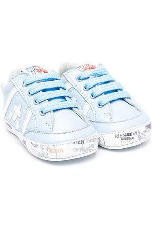 Premiata Logo-patch lace-up sneakers