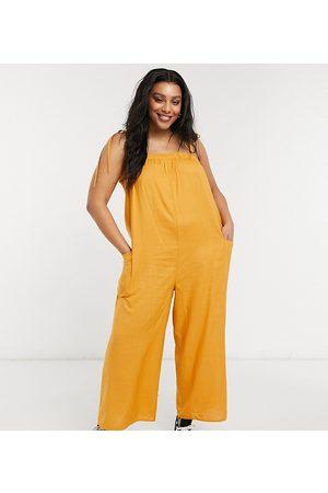 ASOS ASOS DESIGN curve cami minimal pocket jumpsuit in acorn