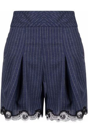 KOCHÉ High-waisted pinstripe shorts