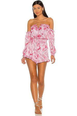 Bunny Tanner Romper in - Pink. Size L (also in XS, S, M).