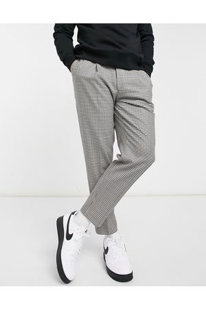 Topman Houndstooth check tapered trousers in dark brown and white