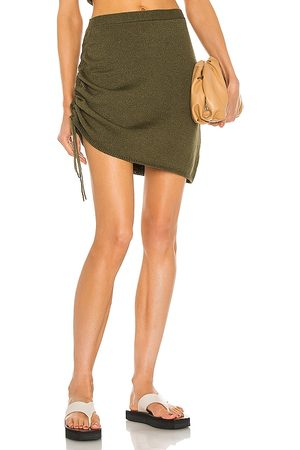 JoosTricot String Mini Skirt in - Olive. Size L (also in XS, S, M).